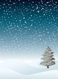 Winter flurry. Evening winter snow flurry with a christmas tree that is decorated Stock Images