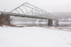 Winter, Foggy Scene At Historic Skinners Fall Truss Bridge Royalty Free Stock Image