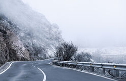 Winter Foggy Winding Road Stock Photos