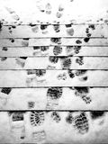 Winter Footprints. Footprints on snow covered steps Stock Image