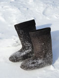 Winter footwear on snow Stock Photo