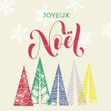 Winter forest background for French Christmas greeting card. Winter forest background with Christmas trees for french greeting card. Joyeux Noel France Merry Royalty Free Stock Photo