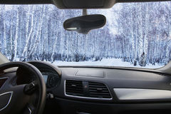 Winter forest in the cabin cars Royalty Free Stock Images