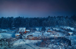 Winter forest and cottages Royalty Free Stock Image