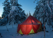 Winter forest and illuminated tent Stock Photos