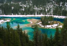 Winter forest lake, Switzerland. A colorful SWISS LAKE CAOMA Stock Images