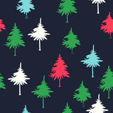 Winter forest. New Year vector seamless pattern with trees. Christmas hand drawn texture with firs silhouettes on dark background Royalty Free Stock Images