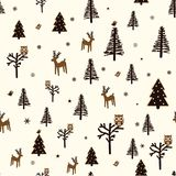 Winter forest pattern. Christmas seamless pattern with woodland animals, trees and snowflakes Royalty Free Stock Images