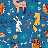Winter forest seamless pattern with cute animals on blue background. vector illustration