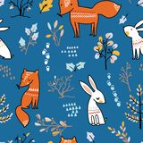 Winter forest seamless pattern with cute animals on blue background. royalty free illustration
