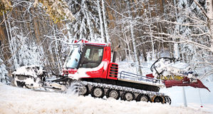 Winter forest with snow thrower Royalty Free Stock Images