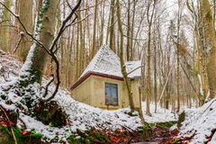 Winter Forrest Creek with Old Water House Stock Photography
