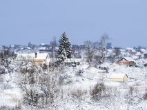 Winter fragmentary landscape. Rural houses. Winter fragmentary landscape.nA lot of snow and light. Freezing day.nlandscape in a frosty day with snow Royalty Free Stock Photography