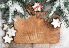 Winter frame decorated with Christmas tree, snow and cookies Stock Image