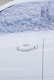 Winter freezing car window, frozen vehicle in the snow Royalty Free Stock Image