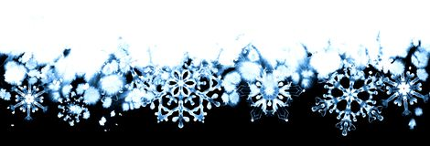 Winter frost with blue snowflakes on black and white background. Hand-painted seamless horizontal border Royalty Free Stock Photos