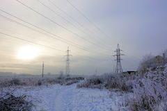 Winter. Frosty landscape. Transmission tower or electricity pylon to support an overhead power line. Russia.  royalty free stock images