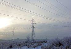 Winter. Frosty landscape. Transmission tower or electricity pylon to support an overhead power line. Russia.  stock photos