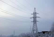 Winter. Frosty landscape. Transmission tower or electricity pylon to support an overhead power line. Russia.  royalty free stock image