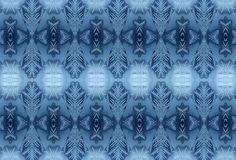 Winter frosty pattern on glass. Background Royalty Free Stock Images