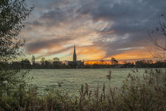 Winter frosty sunrise landscape Salisbury cathedral city in Engl Royalty Free Stock Images