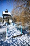 Winter frosty trees and old snowy bridge in the winter park. Winter nature with winter snowy trees Stock Images