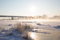 Winter. Frozen river and bridge background Royalty Free Stock Photos