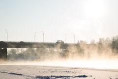 Winter. Frozen river and bridge background Royalty Free Stock Photo
