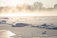Winter. Frozen river and bridge background Stock Photos