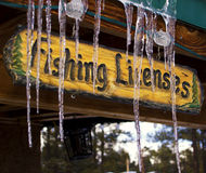 Winter Frozen Wood Sign. A wooden sign hangs from the roof of a log cabin in snowy woods of the White Mountains in mid-eastern Arizona, USA Stock Photos