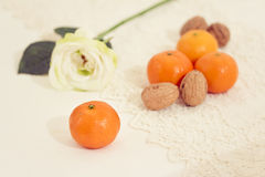 Winter fruits and nuts table decoration. Clementine and nuts on a decorated table Stock Images