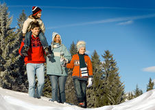 Winter fun 1. Young family in winter landscape Royalty Free Stock Photos