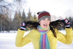 Winter fun. Girl in a yellow jacket, laughing and joking Stock Photography