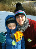 Winter Fun. Mother and son in the snow getting ready to ski stock photo