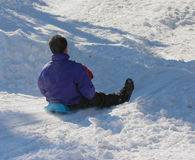 Winter fun. Young man and child on sled royalty free stock photos