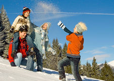 Winter fun 6. Young family having fun in winter landscape Royalty Free Stock Photo