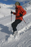Winter fun. Young woman on a snowshoe descent Stock Photo