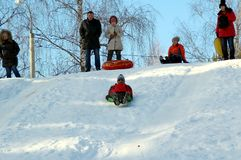 Indian first time riding on a sled. stock images