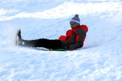 Indian first time riding on a sled. stock photography