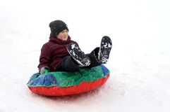The boy rides with his eyes closed. Winter fun. The action takes place on the outskirts of the city of Monino. Residents of the town come with children on a stock images