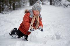 Winter fun. the boy sculpts the snowman. Winter fun. the boy sculpts the snowman stock photos