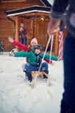 Winter fun - children sledding Stock Image
