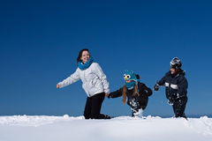 Winter fun in the deep snow - family enjoying the walk Stock Images