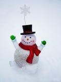 Winter Fun. Happy glass snowman snow globe enjoying the fresh snowfall Stock Photography