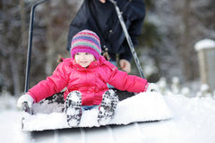 Winter fun: having a ride on a snow shovel royalty free stock images