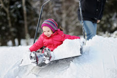 Winter fun: having a ride on a snow shovel Stock Photography