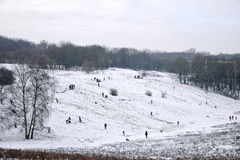 Winter fun on the hills in the snow Stock Photography