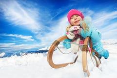 Free Winter Fun In Snow Mountains Girl On Sledge Stock Photo - 68736130