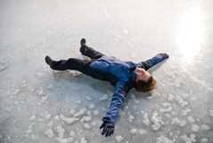 Winter fun - lying on ice Royalty Free Stock Image