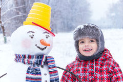 Winter fun! My friend snowman and me are in the winter snow day. Stock Photos